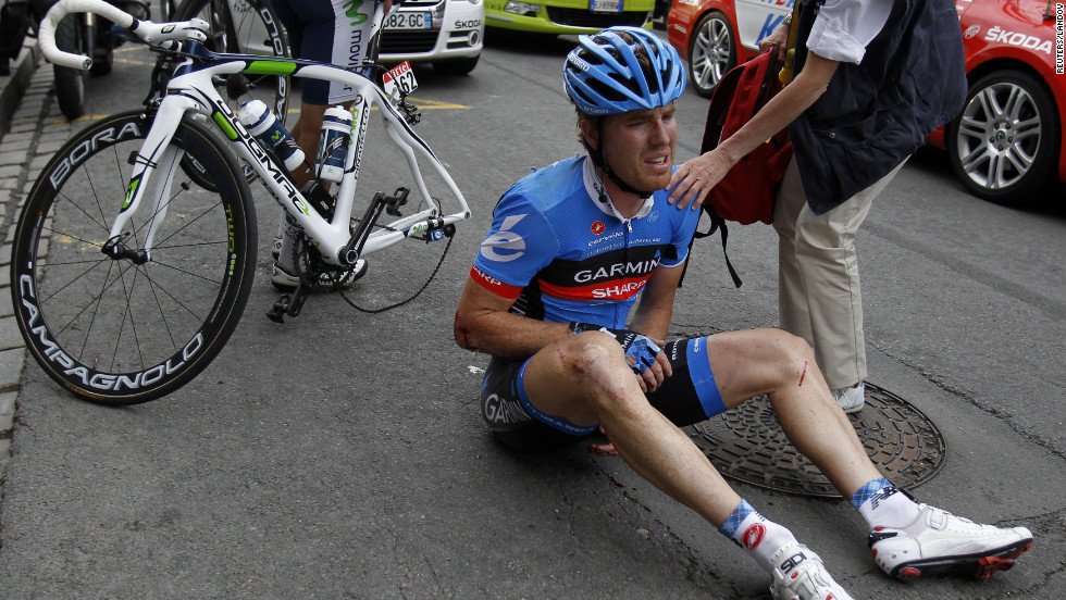 Tyler Farrar of USA riding for Garmin-Sharp sits on the ground dazed after crashing hard near the end of Thursday's stage.