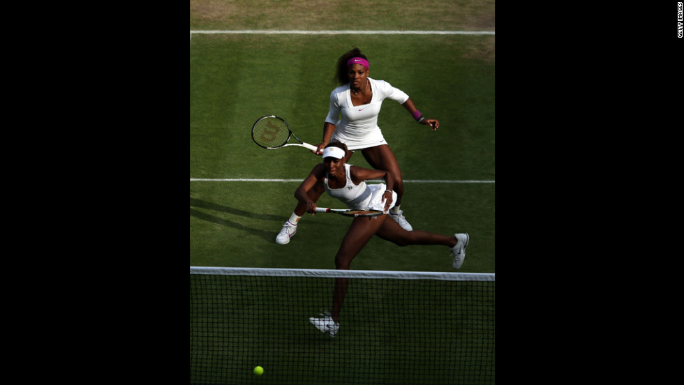 Serena Williams, top,  and Venus Williams of the United States team up in their women's doubles quarter-final match against Raquel Kops-Jones and Abigail Spears of the United States on Thursday.