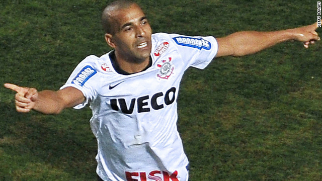 Brazilian striker Emerson scored twice as Corinthians claimed the Copa Libertadores for the first time.