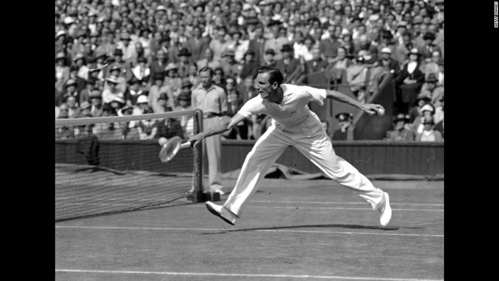 Perry (1909-1995) stretches to return a shot during his semifinal match against Don Budge of the United States at the Wimbledon Lawn Tennis Championships.