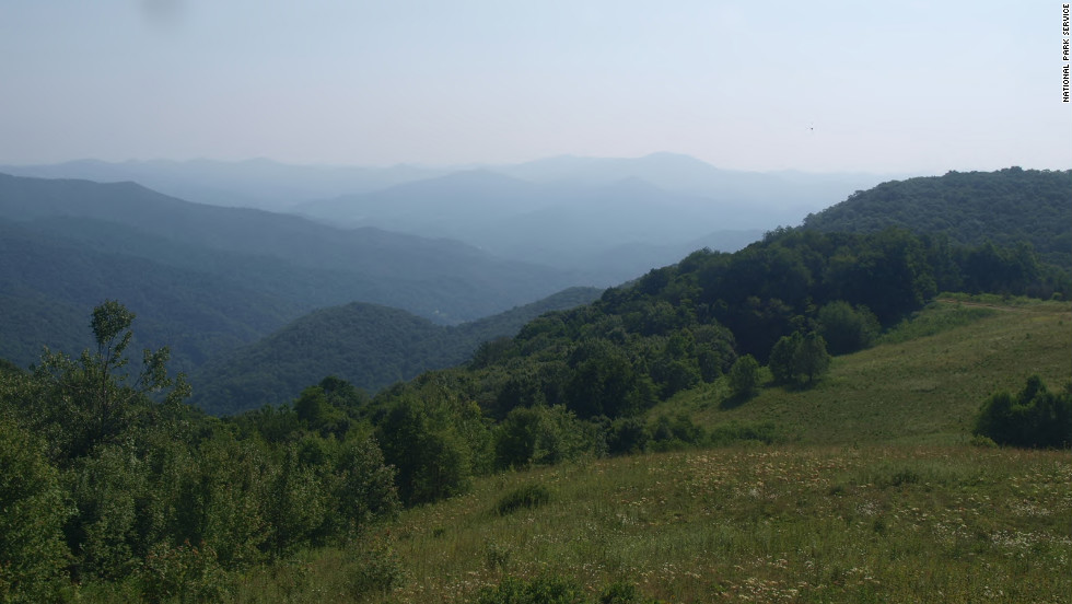 Many of the most famous parks in the world are among the U.S. National Park Service's 59 headliner national parks. Great Smoky Mountains National Park, which was the third most-popular park site in 2013, was also the most popular national park. Shown here is the view from Purchase Knob.