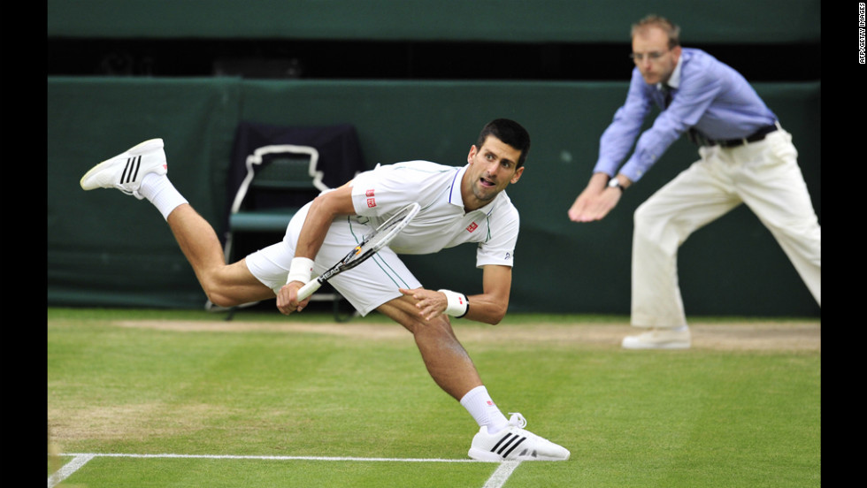 Novak Djokovic reacts during his men's singles semifinal match Friday against Roger Federer.