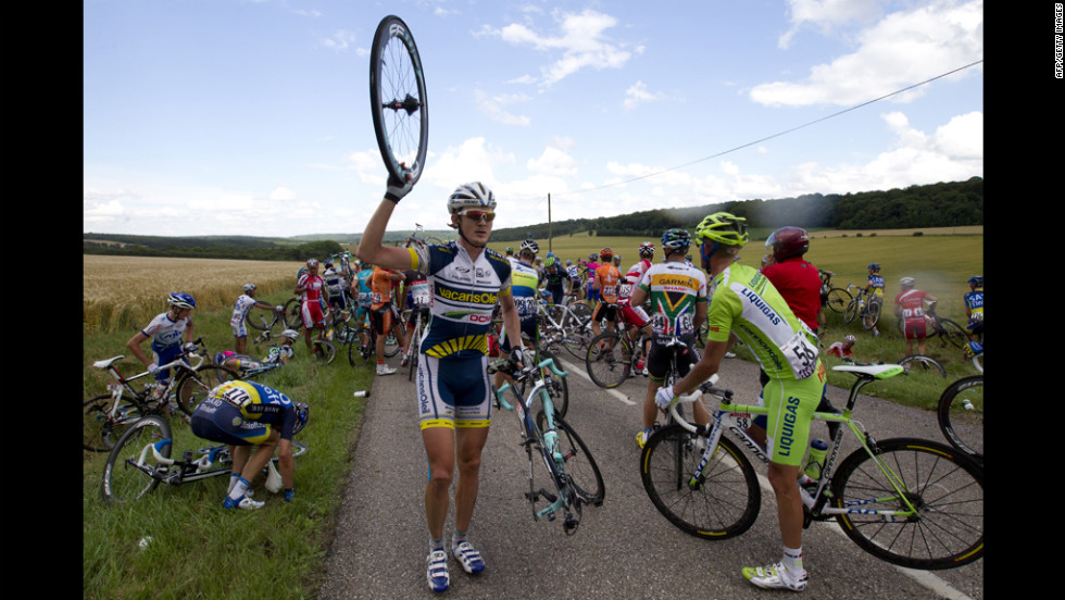 Sweden's Gustav Larsson, center, and Italy's Daniel Oss were among the 30 riders involved in the crash Friday.