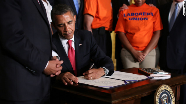 President Barack Obama signs the transportation bill, which also will prevent interest rates on student loans from doubling.