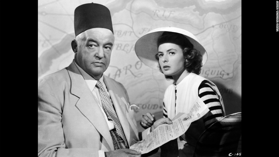 Ilsa and Victor go to see Senor Ferrari (Sydney Greenstreet) a black-market dealer, to acquire exit visas.