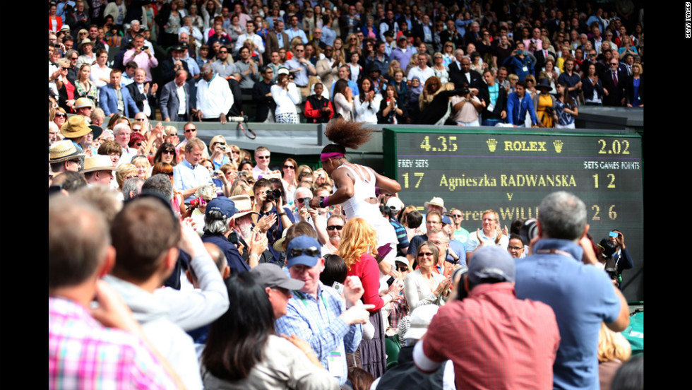 "U.S. player Serena Williams rushes through the stands to celebrate with her family after <a href=""http://www.cnn.com/2012/07/07/tennis/gallery/womens-singles-wimbledon/index.html?hpt=hp_t1"" target=""_blank"">winning the women's singles final</a>, her fifth Wimbledon championship, on Saturday."