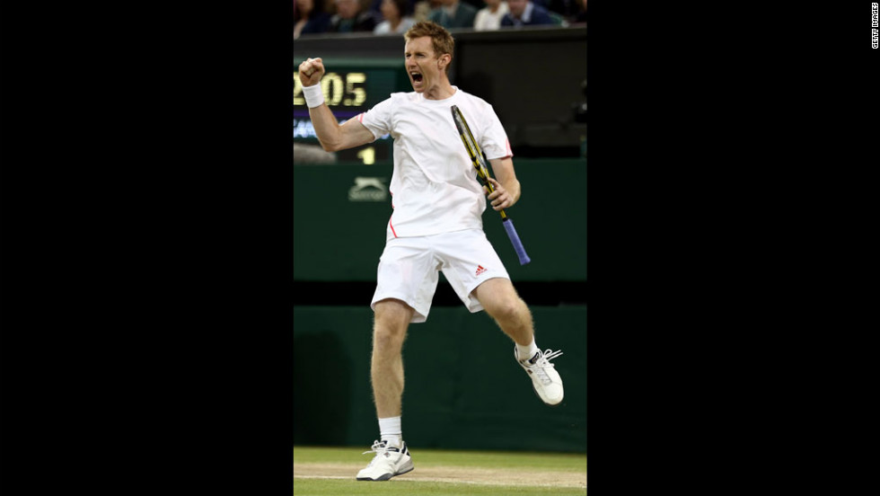 Britain's Jonathan Marray celebrates a point during the men's doubles final match at Wimbledon on Saturday, July 7. Marray was teamed with Denmark's Frederik Nielsen against Romania's Horia Tecau and Sweden's Robert Lindstedt.