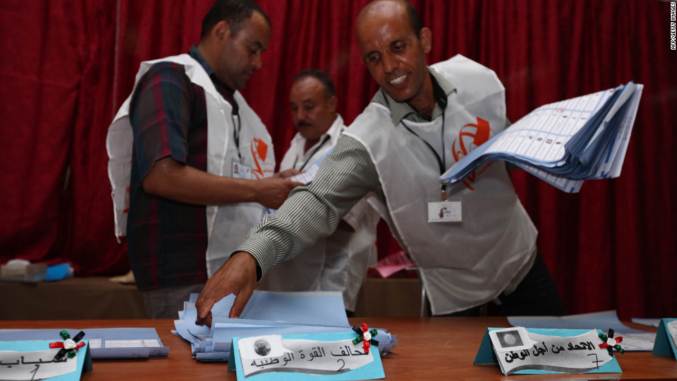 Election officials begin sorting ballots at a polling station in Tajura following Libya's General National Assembly election.