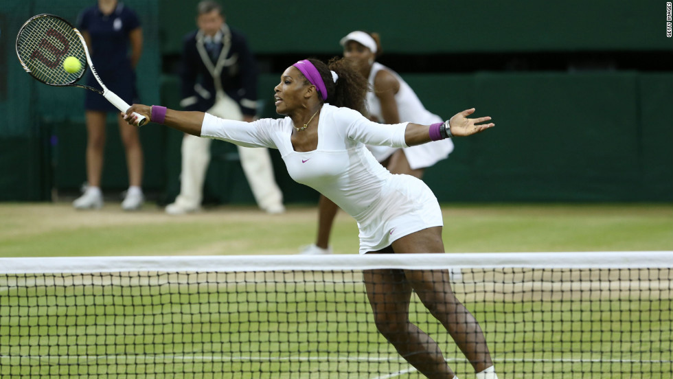 Serena Williams hits a volley during women's doubles final.