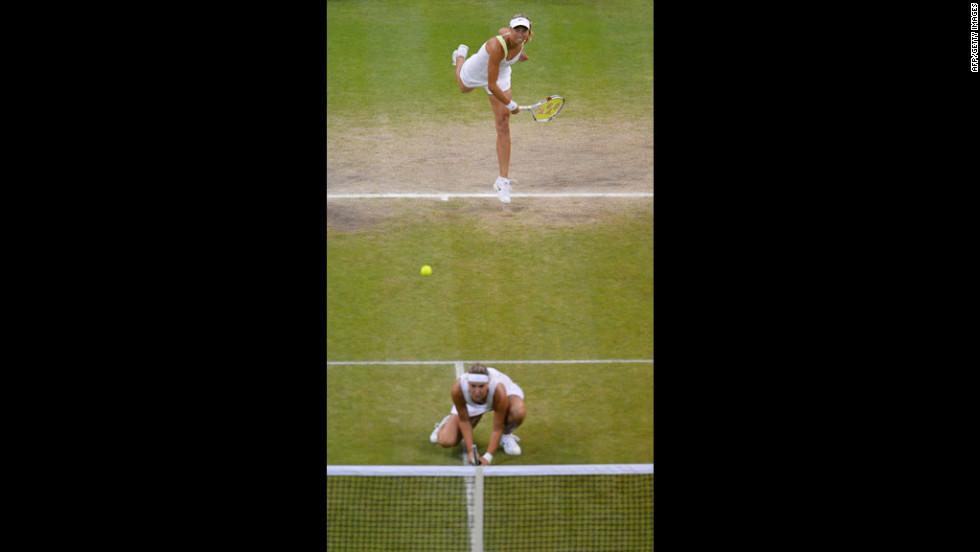 Czech Republic's Lucie Hradecka crouches as Andrea Hlavackova serves during their women's doubles final match against Venus and Serena Williams.