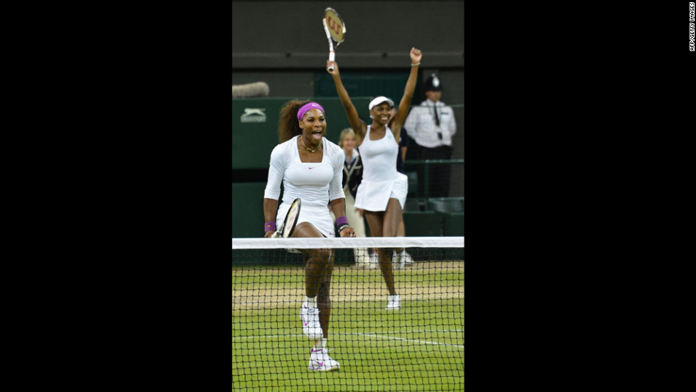 Sisters Serena and Venus Williams of the United States celebrate following their win against Czech Republic's Andrea Hlavackova and Lucie Hradecka in the women's doubles final on Saturday.