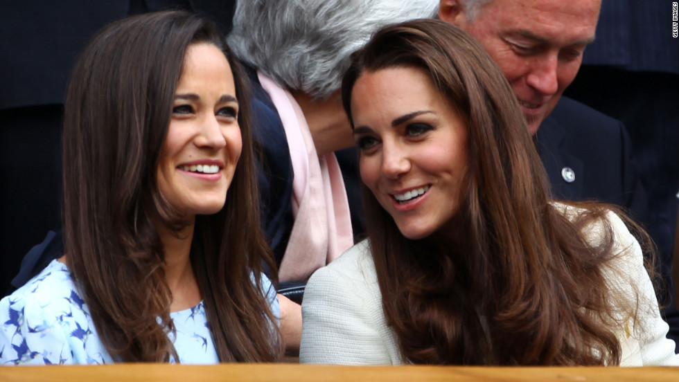 Pippa Middleton, left, and her sister, Catherine, Duchess of Cambridge, sit in the royal box during the match between Federer and Murray on Sunday.