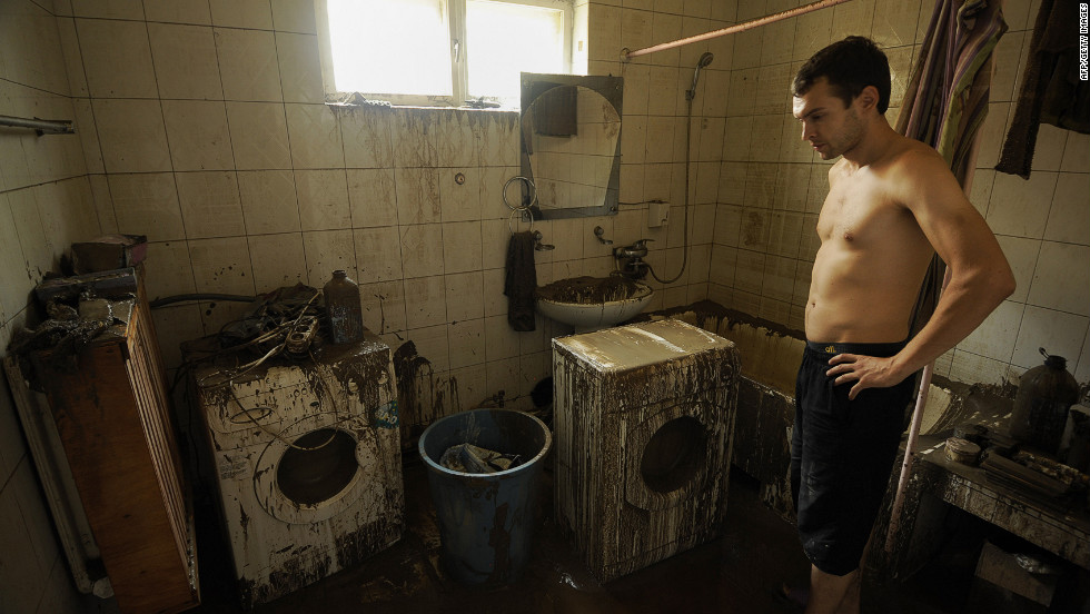 A resident of Krymsk walks through his damaged home after floodwaters receded Sunday.