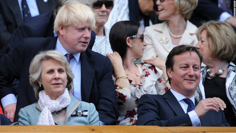 London's Mayor Boris Johnson, top left, and Britain's Prime Minister David Cameron, right, attend the match Sunday.