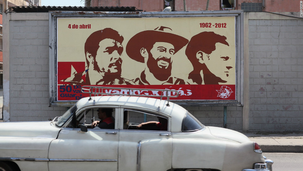 Some of the Castro regime's battle to control perceptions in Cuba is played out on billboards across the capital Havana. Here, a billboard shown in 2012 celebrates (L-R) Che Guevara, Camilo Cienfuegos and Julio Mella, three of the country's revolutionary heroes.