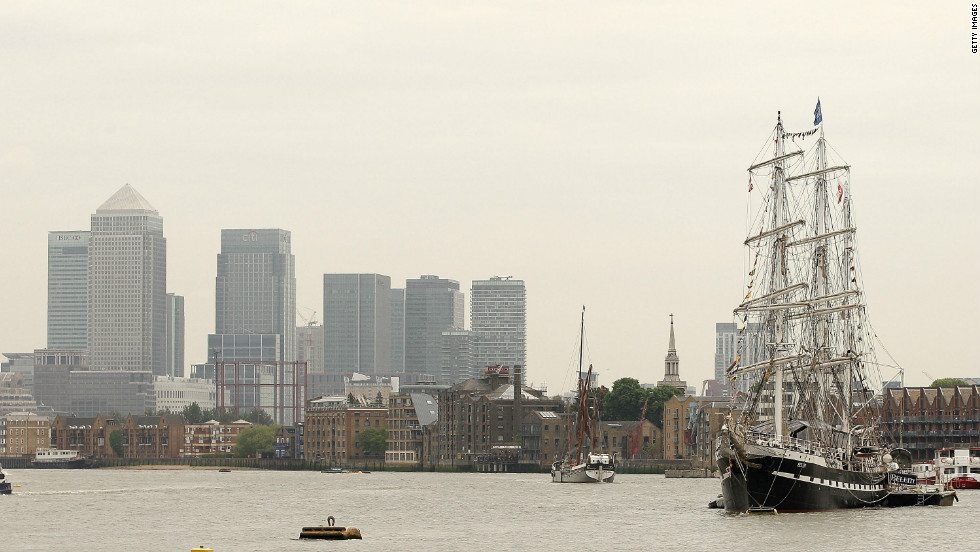 The financial hub of Canary Wharf looms behind the Prince of Wales ahead of the Diamond Jubilee pageant. By 1980 most of London's docks were obsolete. It wasn't until the London Docklands Development Corporation redeveloped the site in the late 1980s that the struggling area was reborn.