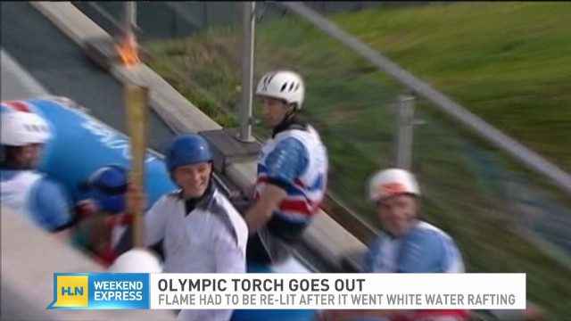 Olympic torch extinguished while rafting