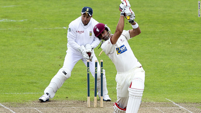 Wicketkeeper Mark Boucher is struck in the eye by a flying bail during South Africa's game with Somerset