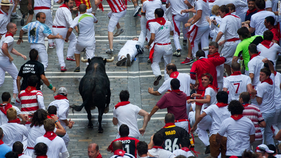 A bull chases revelers on the third day of the annual Running of the Bulls.