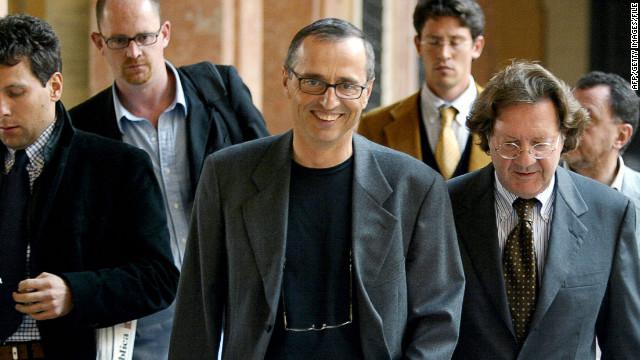 Italian sports doctor Michele Ferrari, center, leaves a tribunal in Bologna, Italy, in 2004.