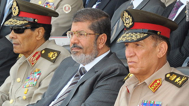 handout picture released by the Egyptian presidency on July 9, 2012, shows Egyptian President Mohamed Morsi (C), head of the military council Field Marshal Hussein Tantawi (L) and Egyptian armed forces Chief of Staff Sami Anan (R) as they attend a graduation ceremony of military cadets, in the capital Cairo. Egypt's top court rejected a decree by President Morsi to reinstate the parliament it ruled invalid, setting him on a collision course with the judiciary and the military which enforced the ruling.