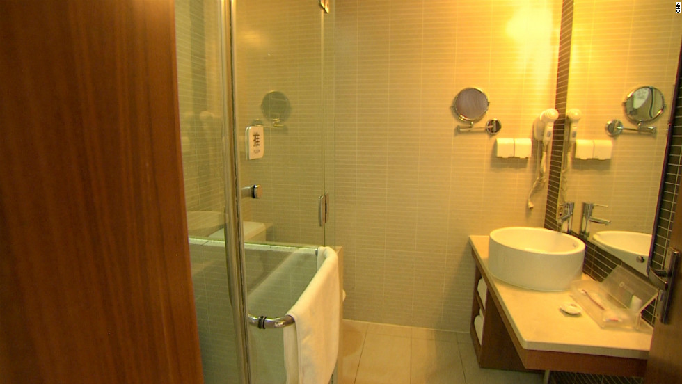 "An en-suite bathroom in a Hanting Inns hotel. The chain invests ""serious money"" into its rooms, says Ji Qi."