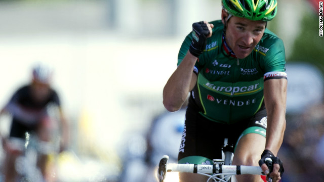 Thomas Voeckler crosses the line to win the 10th stage of the Tour de France.