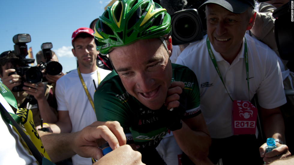 France's Thomas Voeckler celebrates after winning stage 10, a 194.5-kilometer (120-mile) course starting in Macon and finishing in Bellegarde-sur-Valserine, France, on Wednesday, July 11.