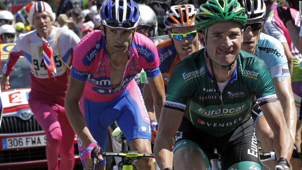 Thomas Voeckler of France, right, leads a breakaway group of four riders through the mountains.