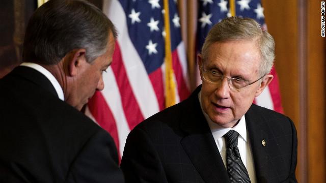 In a rare cordial moment on Capitol Hill, Senate Majority Leader Harry Reid, right, talks with House Speaker John Boehner.