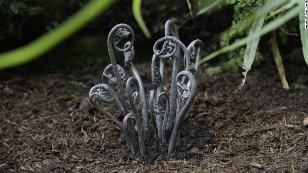 "Jo Coupe's casts plants in lead, creating deathly-looking objects. ""Lead is not an environment-friendly material, it's visually deadly,"" Coupe says. ""It's a metaphor for life and death."""