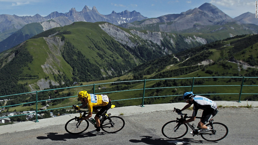 Bradley Wiggins of Great Britain, left, rounds a turn Thursday, followed by teammate Christopher Froome.