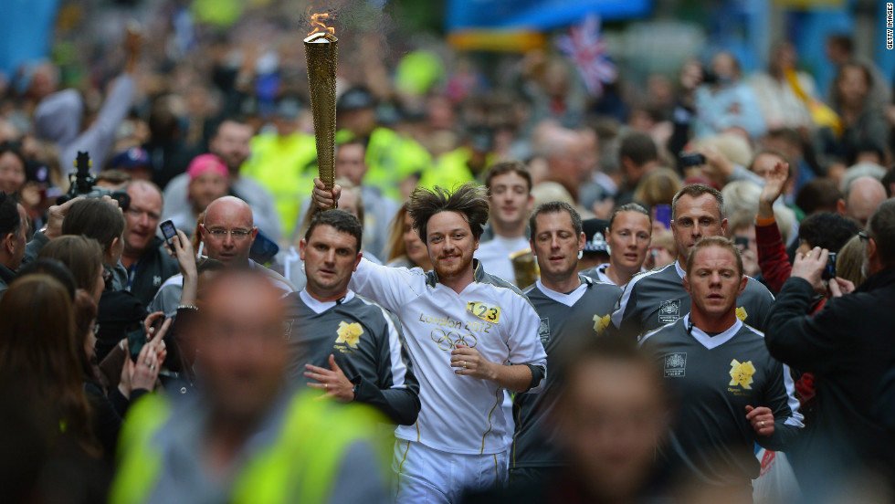 Actor James McAvoy carries the torch down Buchanan Street in Glasgow, Scotland, on June 8.