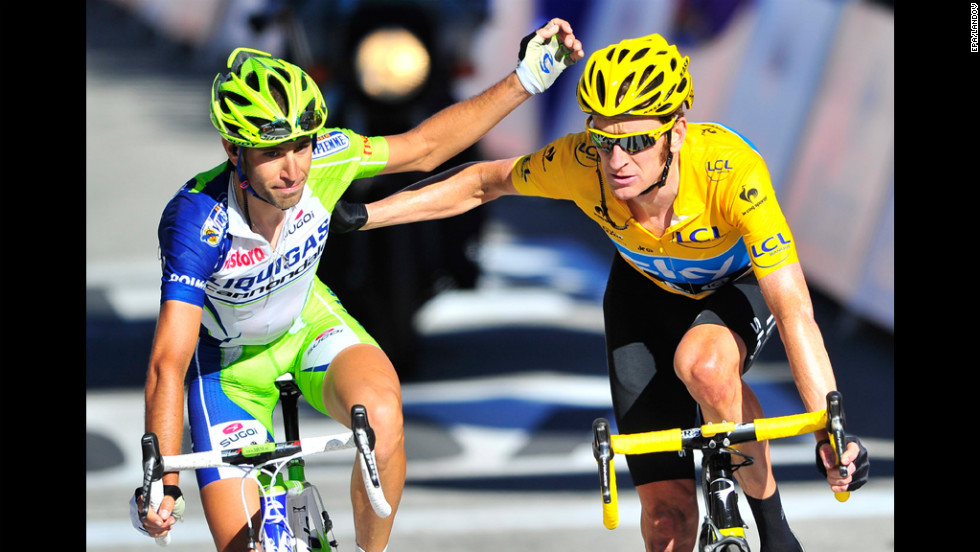 Vincenzo Nibali of Italy, left, and Bradley Wiggins of Britain celebrate at the conclusion of Thursday's race.