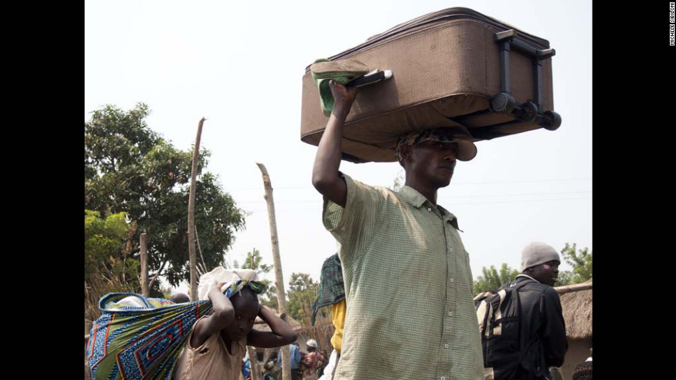 Refugees escape to a refugee camp in Kiwanja on July 8, a trek made more dangerous by the looting of the Congolese army.