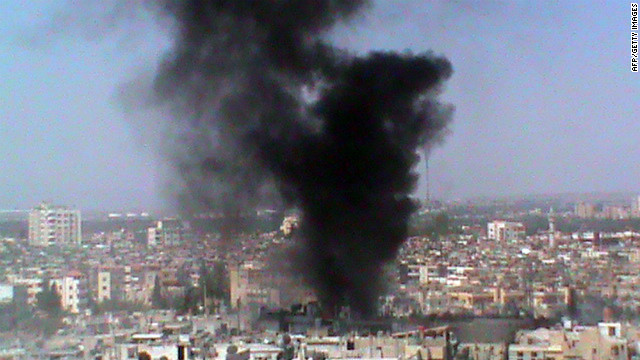A picture released by the Syrian opposition shows smoke rising from a Homs neighborhood Wednesday.