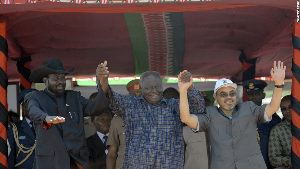 Left to right: President Salva Kiir of South Sudan, President Mwai Kibaki of Kenya and Meles Zenawi, Prime Minister of Ethiopia, raise their joined hands on March 2, 2012 following the ground breaking ceremony of LAPSSET.