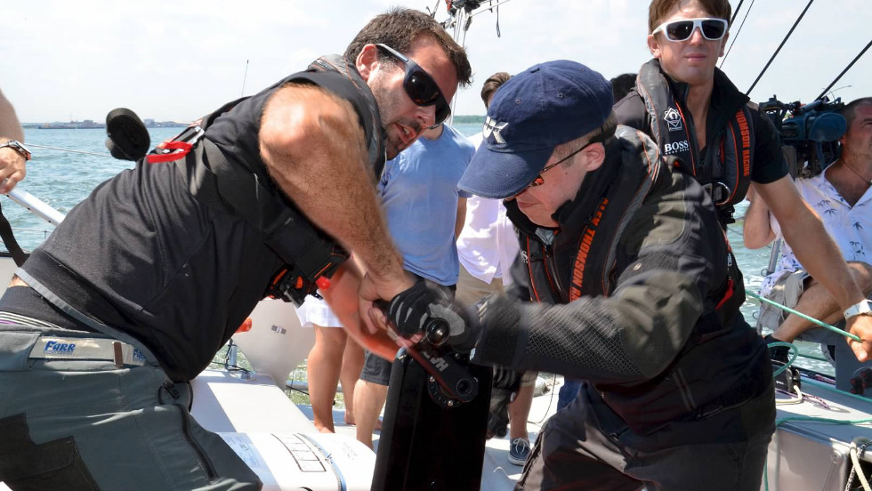Crew demonstrates moving a sail - something Alex Thomson will have to do on his own when he attempts to travel solo around the world.