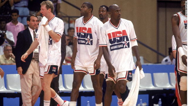 "Larry Bird, from left, Magic Johnson and Michael Jordan of the USA  ""Dream Team"" walk on court at the 1992 Olympics."