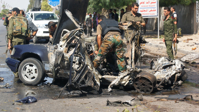 Syrians inspect the site of a car bombing in Damascus on Friday. Among the issues facing the U.S. is how to deal with Syria.