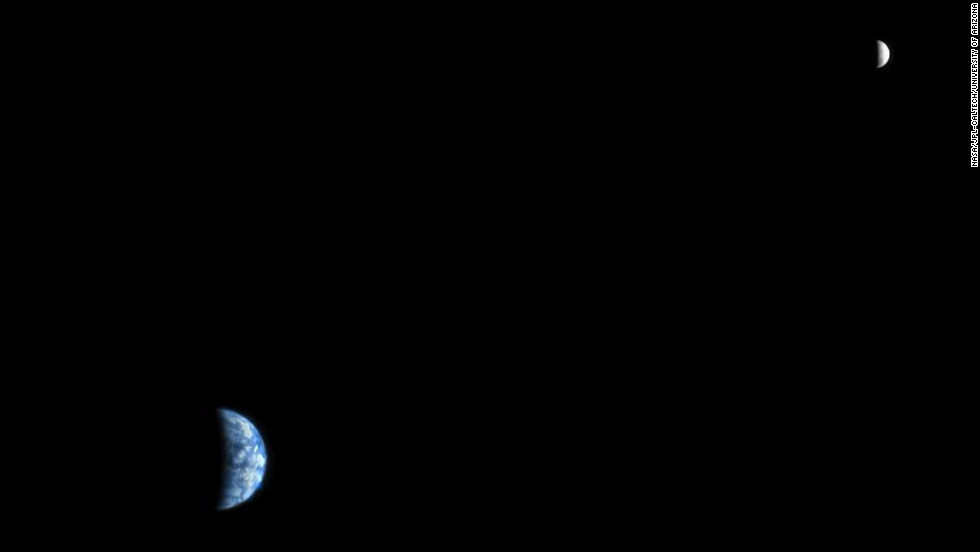 Earth and the moon are seen in 2007 from the Mars Reconnaissance Orbiter. At the time the image was taken, Earth was 142 million kilometers (88 million miles) from Mars.