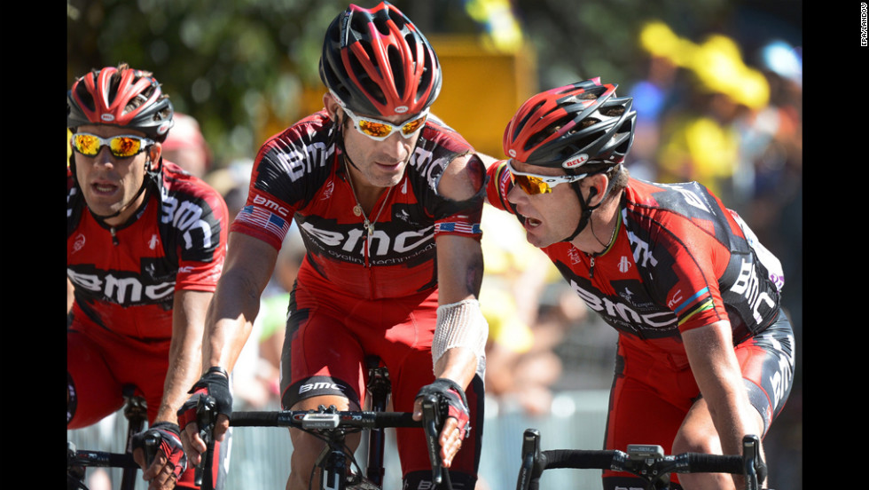 George Hincapie, of the United States and Cadel Evans of Australia on Team BMC talk during Wednesday's race.