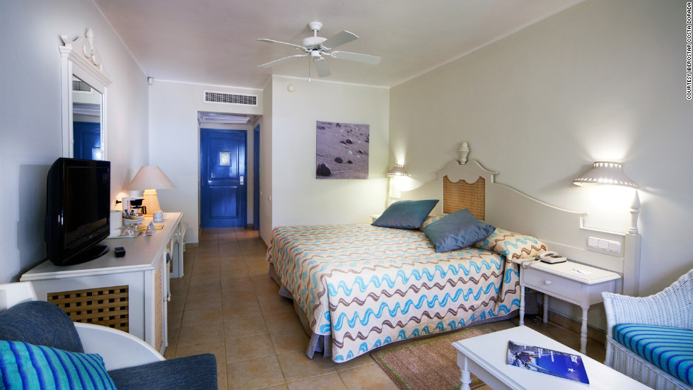 """The 516 rooms at the Iberostar Costa Dorada in Puerta Plata are located in thatch-roof buildings painted cheerful shades of yellow and purple. <a href=""""http://www.budgettravel.com/slideshow/photos-best-budget-beachfront-all-inclusives,8613/ """" target=""""_blank"""">See more photos of the resorts at BudgetTravel.com</a>"""
