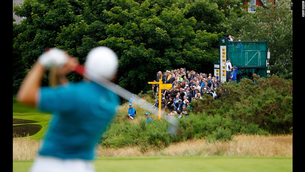 Spectators watch the action as Sergio Garcia of Spain hits a tee shot during the first round Thursday.