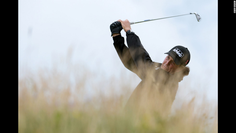 Phil Mickelson of the United States hits his tee shot on the 11th hole on Thursday.