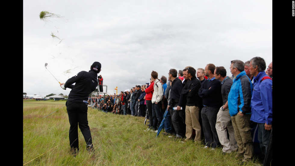 Rory McIlroy of Northern Ireland hits his second shot on the 14th hole on Thursday.