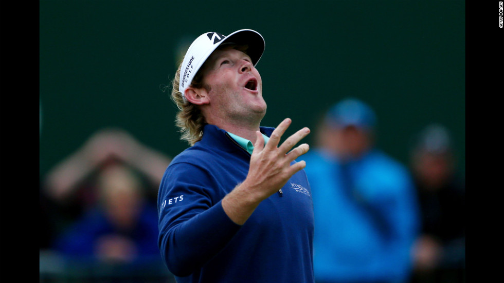 Brandt Snedeker of the United States reacts to his putt on the 18th hole during the first round on Thursday.