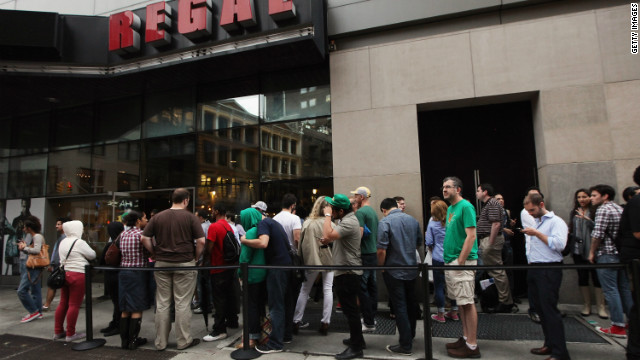 "People waiting to see ""The Dark Knight Rises"" in New York City on Friday."