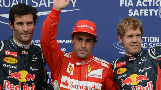 Spain's Fernando Alonso (center) was quickest in Saturday's qualifying session for the German Grand Prix at Hockenheim.