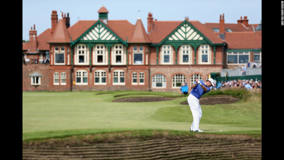 Lee Westwood of England hits his approach to the 18th green.